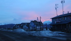 Businesses on Homer Spit mostly closed for the winter, pink sunset, mountains, communication towers, cell, radar, snow berms, Homer, Alaska, USA