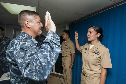 SAN DIEGO - Capt. Shawn Lobree, commander, Amphibious Squadron Three, promotes Lt. Tess Messiah, from amphibious dock landing ship USS Rushmore (LSD 47) and Lt. Evan Messiah, from Amphibious Squadron (COMPHIBRON) Three, aboard amphibious assault ship USS Peleliu (LHA 5).