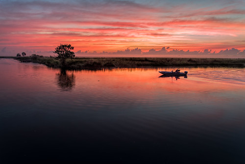sky orange usa cloud reflection tree reed water weather sunrise river landscape dawn boat fishing florida cloudy explore swamp boating marsh cocoa centralflorida rivergrass edrosack