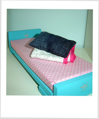 Cama de bonecas