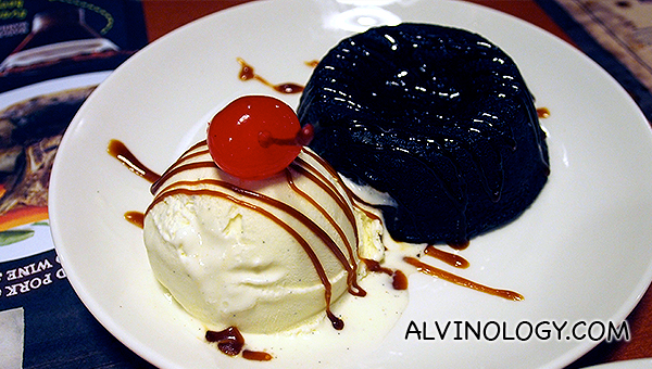 Chocolate lava cake, served with vanilla ice cream and caramel sauce - S$14.90