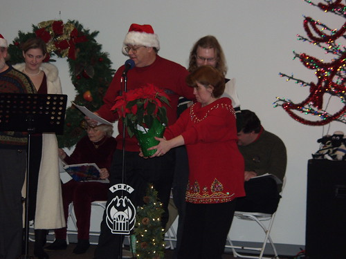 Clair Kiernan presents the traditional Christmas poinsettia.