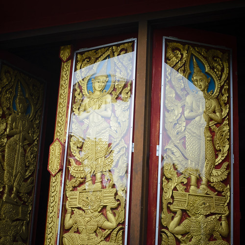 Detailed wood carving windows of the Dragon Boat temple.