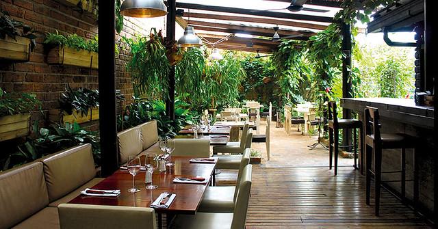 Santiago bustamante el artista de los asados cromos for Restaurante jardin botanico