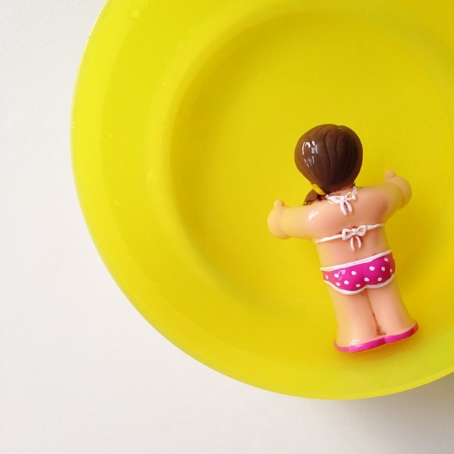 Bath toy taking a dip in her yellow pool... #capturingcolour #yellow