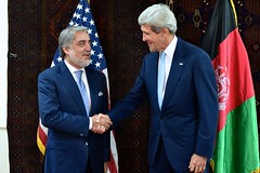 Afghan presidential candidate Abdullah Abdullah appears before reporters with U.S. Secretary of State John Kerry on July 11, 2014, after he arrived at the U.S. Embassy in Kabul, Afghanistan for a meeting about steps to resolve the country's disputed presidential election between him and fellow candidate Ashraf Ghani. [State Department photo/ Public Domain]