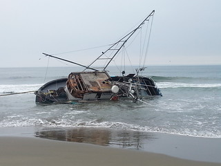 The fishing Vessel Paloma aground near Ocean Beach, Calif., Tuesday, August 5, 2014. Coast Guard pollution responders worked closely with the National Parks Service on pollution recovery efforts after the active search for the Paloma's missing operator was suspended Monday.