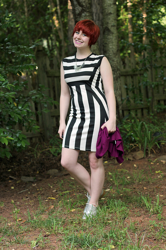 Black and White Striped Bodycon Dress with Short Red Hair and Silver Shoes