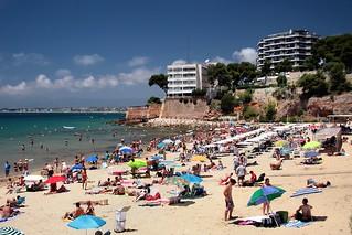 Image of Cala dels Capellans. sea beach coast mar seaside spain mediterranean gente crowd playa umbrellas tarragona mediterráneo salou crowded platja sombrillas