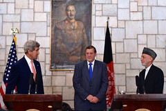 U.S. Secretary of State John Kerry, joined by United Nations Assistance Mission in Afghanistan head Jan Kubis, thanks Afghan President Hamid Karzai as he addresses reporters on the Presidential Palace Grounds in Kabul, Afghanistan, on July 12, 2014, about a deal on a technical and political plan the Secretary helped broker to resolve an election dispute between rival presidential candidates Ashraf Ghani and Abdullah Abdullah. [State Department photo/ Public Domain]