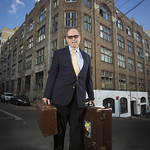 Geoffrey Edgar Sherington with Globite suitcases outside the former Globite Building