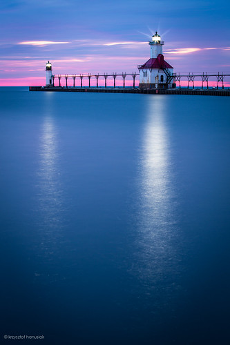 ocean blue sunset sea sky lighthouse reflection water beautiful clouds mi sunrise lights pier marine colorful unitedstates michigan horizon magenta stjoseph lagoon lakemichigan direction maritime waters navigation molo hanusiak