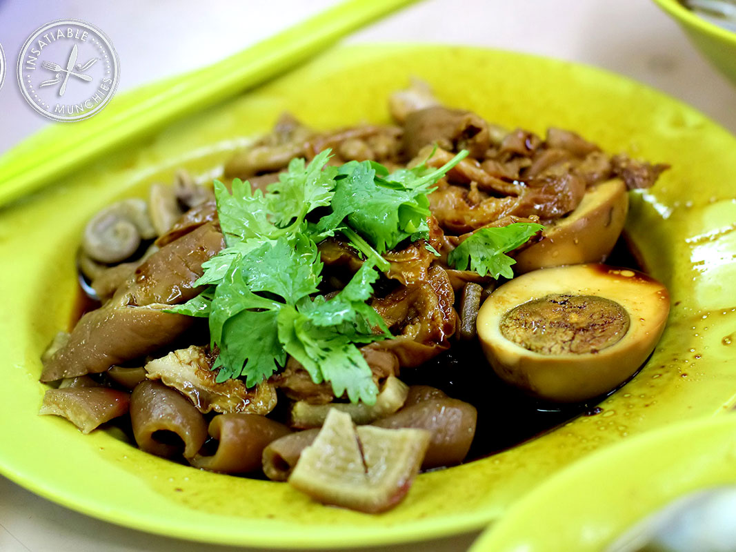 Pig's large and small intestine, skin, firm tofu, boiled egg, as well as a few other choice ingredients are all stewed till tender in a spiced soy broth, and served alongside a bowl of silky rice noodles.