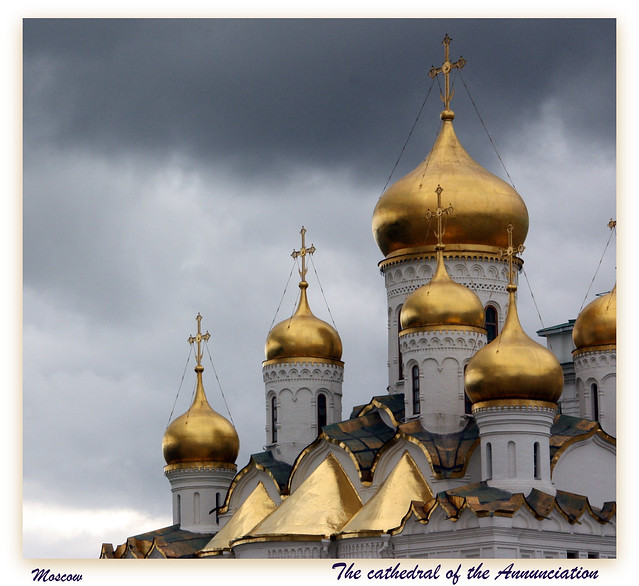 Moscow, On the Cathedral Square.   the gilded onion domes of the Annunciation Cathedral
