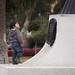 Niño frente a estatua. Av. Brasil, Antofagasta.