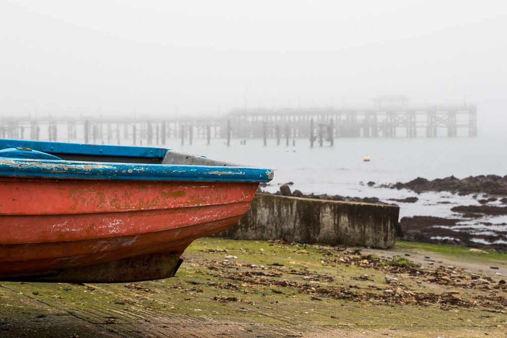 foggy pier and red boat - Click to show full size