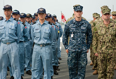 U.S. Navy and Japan Maritime Self-Defense Force (JMSDF) sailors stand in formation with Australian counterparts aboard JS Kunisaki (LST 4003) after its arrival in Cambodia June 19 for Pacific Partnership. (U.S. Navy/MCC Greg Badger)