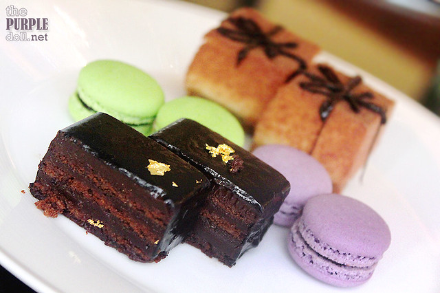 Flourless Milk Chocolate Guanaja Cake, Pistacho Orange Cake and Macarons