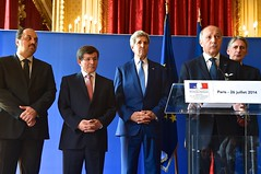 U.S. Secretary of State John Kerry listens along with his counterparts from Germany, Italy, Qatar, Turkey, and the United Kingdom as French Foreign Minister Laurent Fabius delivers a joint statement at the Quai d'Orsay in Paris, France, on July 26, 2014, after a group meeting about a cease-fire in the fighting between Israel and Hamas in the Gaza Strip. [State Department photo/ Public Domain]