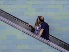 Couple on Escalator, kissing