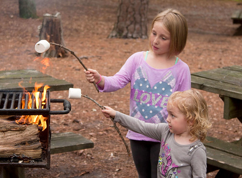 Madelyn Morrissey (left) and Katie Roth roast marshmallows near the George Washington/Jefferson National Forest. (Courtesy Adrian Roth)