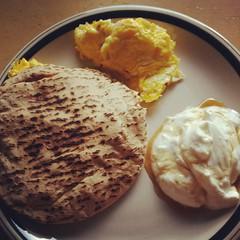 Egg, tofu and pepper jack scramble with pita, and greek yogurt with agave sweetener. #breakfast