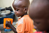 Emmanuel John, a two-year-old child with malnourishment, drinks milk at the malnutrition ward in Al Shabbab hospital in Juba, South Sudan.  © Albert Gonzalez Farran, UNICEF
