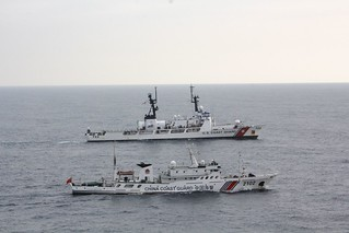 The Coast Guard Cutter Morgenthau and China coast guard vessel 2102 steam alongside each other during the transfer of the fishing vessel Yin Yuan in the North Pacific Ocean June 3, 2014. The Morgenthau crew was patrolling in support of Operation North Pacific Guard, the Coast Guard's component of a multi-lateral fisheries law enforcement operation designed to detect and deter illegal, unreported and unregulated fishing activity. U.S. Coast Guard photo by Coast Guard Cutter Morgenthau.