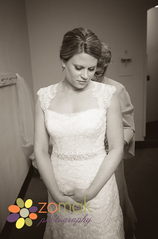 Bride getting dressed with mother's help