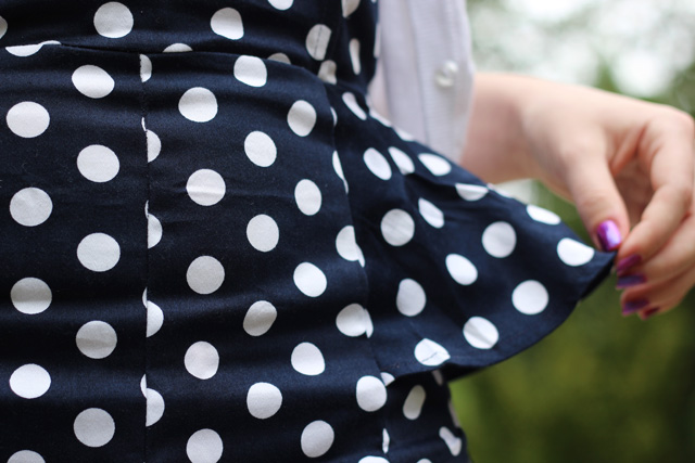 Polka Dot Romper with a Peplum Detail