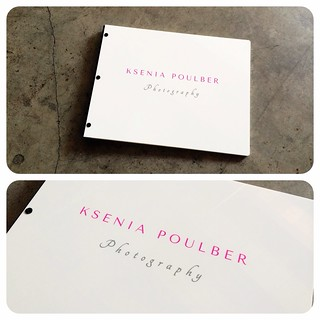 Custom photography portfolio book in white acrylic with vinyl decal treatment and powder black binding