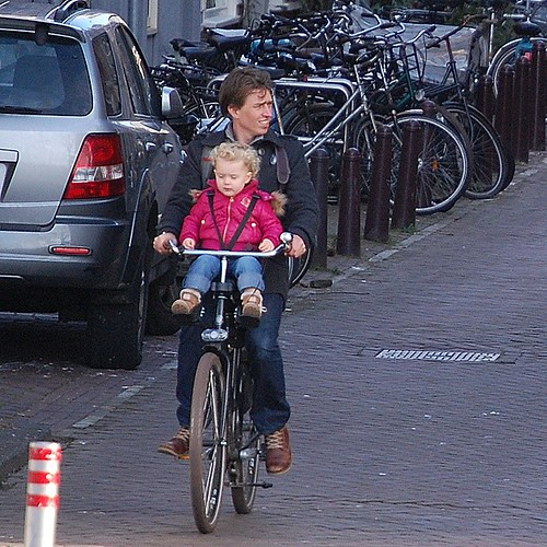 Father and daughter cycling #daddyday #nofilter #amsterdam #cycling #growingupinholland #dutchbike #bikeseat #familycycling #bicicleta #cyclechic