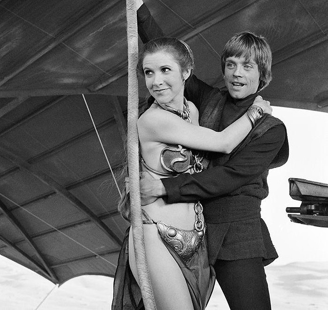 Carrie Fisher (Princess Leia) and Mark Hamill (Luke Skywalker) on location in California's Buttercup Valley aboard Jabba's barge, April 1982