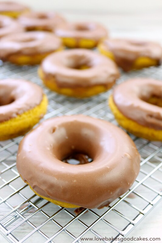 Pumpkin Donuts with Nutella Glaze on a cooling rack.