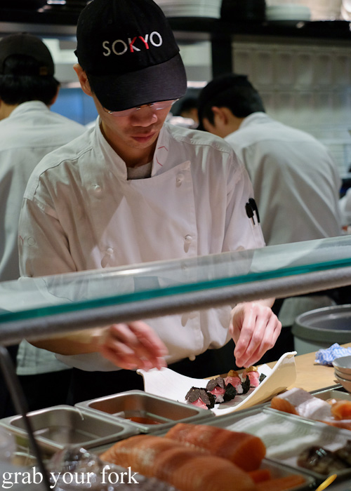 Sushi chef preparing bluefin tuna belly, white sea urchin and black truffle sushi at Sokyo at The Star, Pyrmont