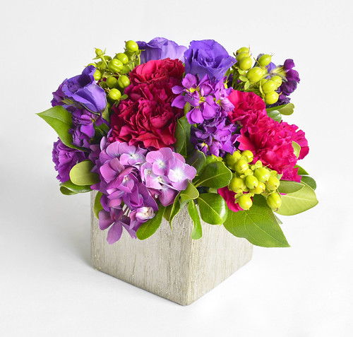 Purple Floral Centerpiece in Silver Vase
