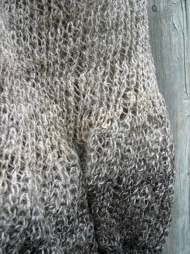 Lower section detail of hand prepared and handspun wool knitted mesh bag by irieknit