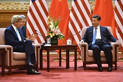 U.S. Secretary of State John Kerry speaks with Chinese President Xi Jinping to discuss the conclusion of the 5th Annual U.S.-China People-to-People Exchange and Sixth Strategic and Economic Dialogue between the two nations on July 10, 2014. [State Department photo/ Public Domain]