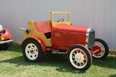 touring car(0.0), tractor(0.0), automobile(1.0), wheel(1.0), vehicle(1.0), ford model tt(1.0), antique car(1.0), vintage car(1.0), land vehicle(1.0), motor vehicle(1.0),