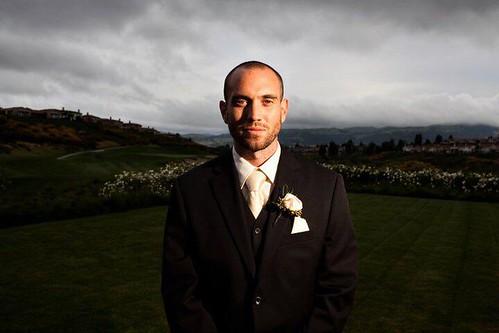 classic groom black tuxedo close up