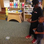 Malachi teaching Lakhari how to fly an r/c helicopter