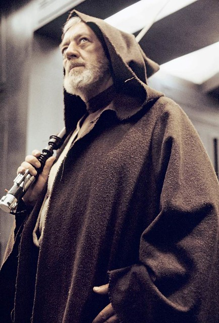 Sir Alec Guinness with a lightsaber