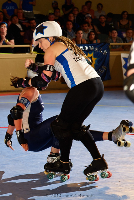 Taraism busts through the pack with a big hit on Denver's Captain Salvador.