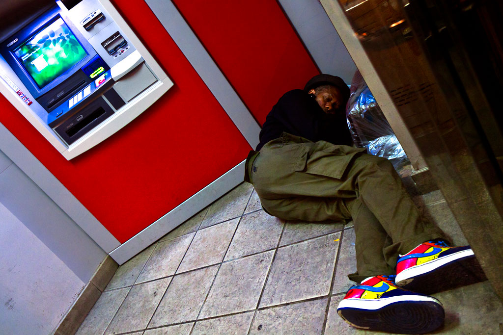 Man-sleeping-inside-ATM-enclosure-on-9-14-14--Center-City