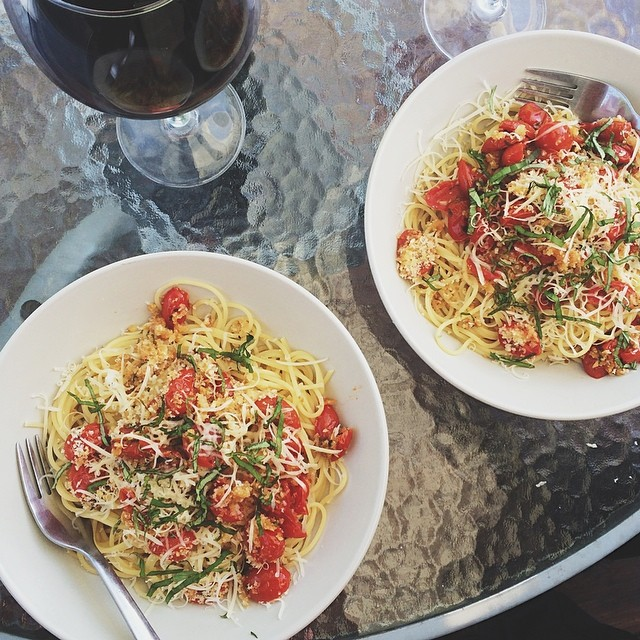 New favorite dinner: @tasteandtell's tomato basil bake over pasta. Al fresco and with wine, of course.