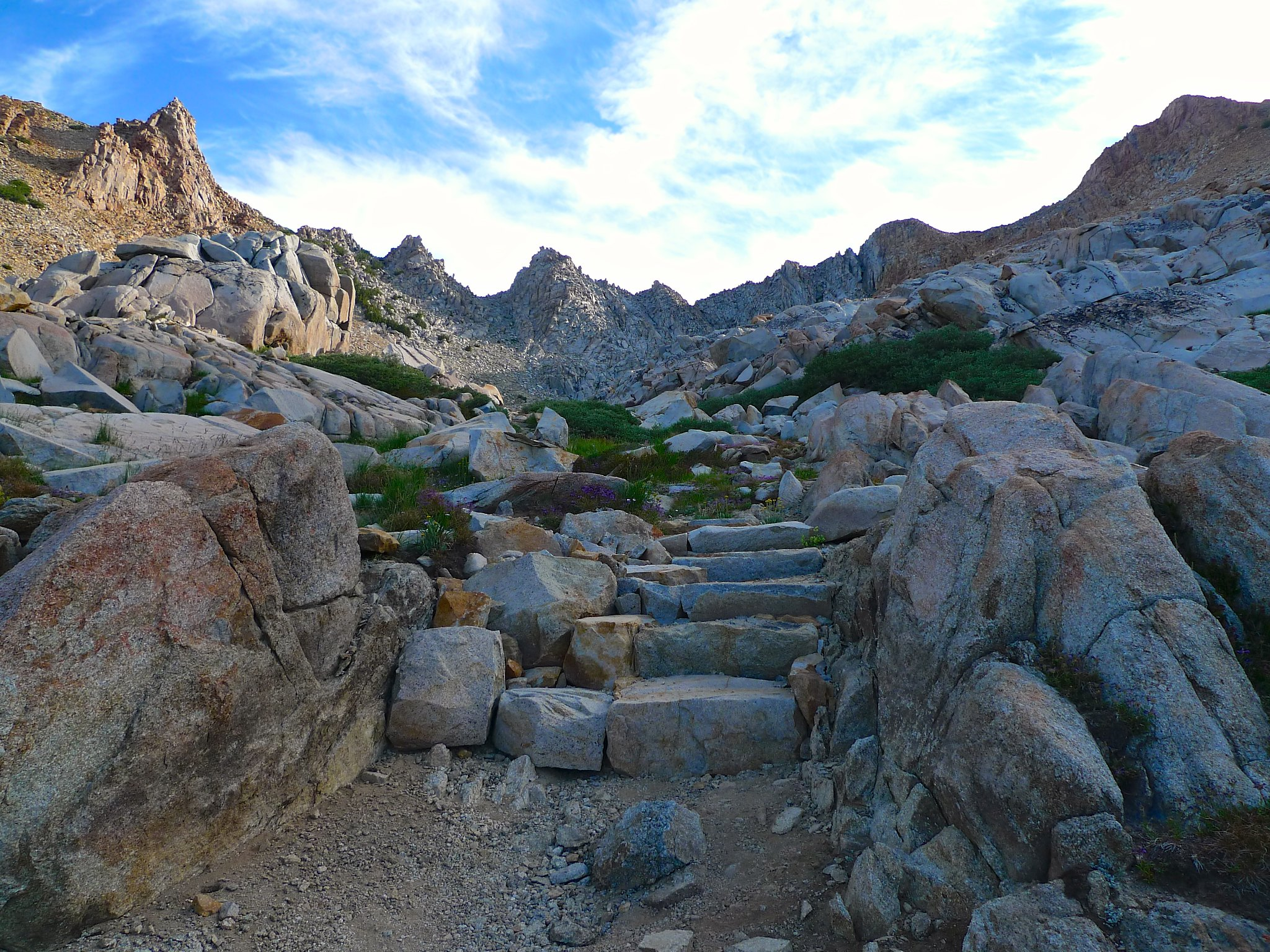 Climbing higher and higher on the Red Peak Pass trail. The pass is in the dip between the two close gray peaks towards the left.