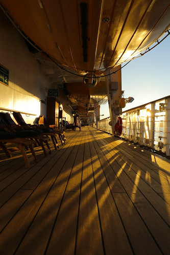 travel cruise light sunset vacation sun canada ship shadows chairs britishcolumbia perspective disney deck lifeboat insidepassage disneywonder johnstonestrait mountwaddingtona