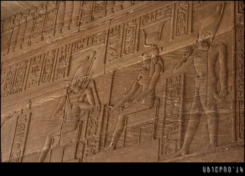 Naked Pharaoh as a child before Hathor and Osiris