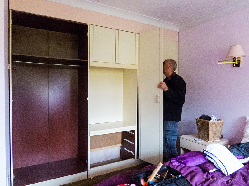 Taking out the fitted wardrobes