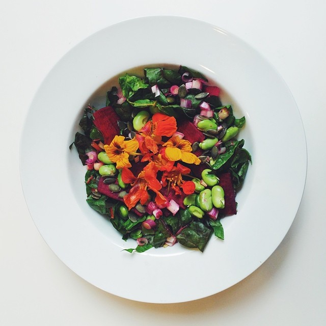 Broad beans week, raw salad. Broad beans, beetroot, spring onions, pumpkin seeds, chard, nasturtium flowers, cider vinegar, date syrup, extra virgin olive oil. #raw #salad  #vegetarian #vegan   #happydesksalad #desklunch #desk #rawfood #rawvegan #veg #veg